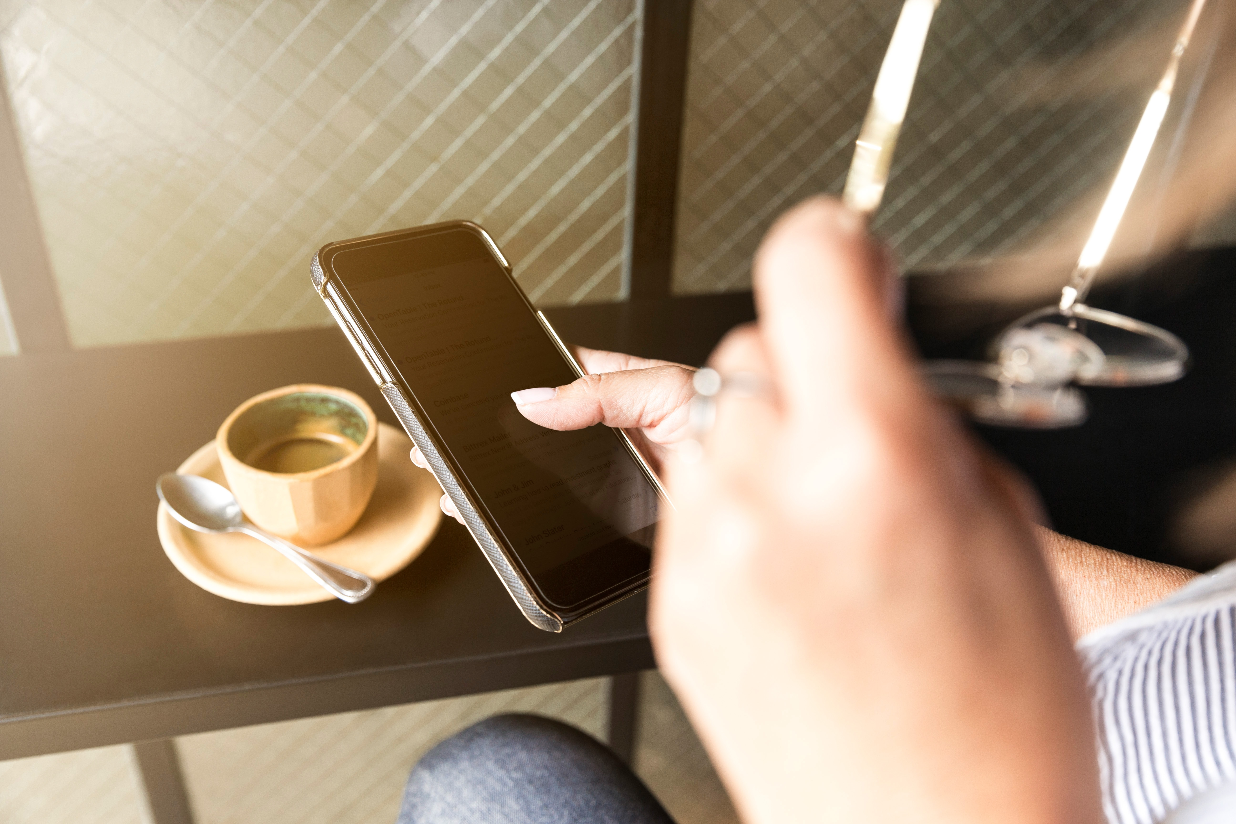 Woman photographing coffee with smartphone