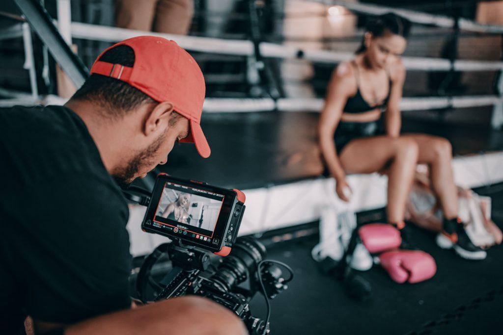 Man filming woman